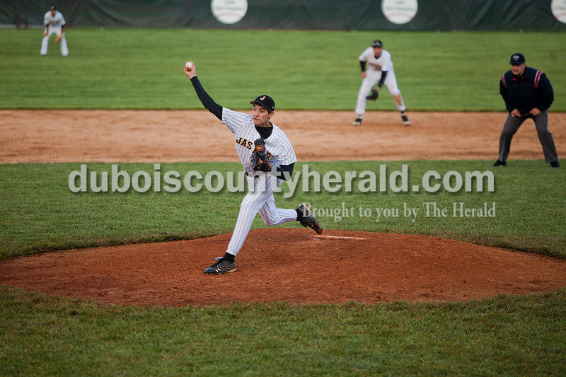 Rachel Mummey/The Herald<br /> Jasper's Seth Hollinden pitched during their game against Heritage Hills at Ruxer Field on Monday evening.