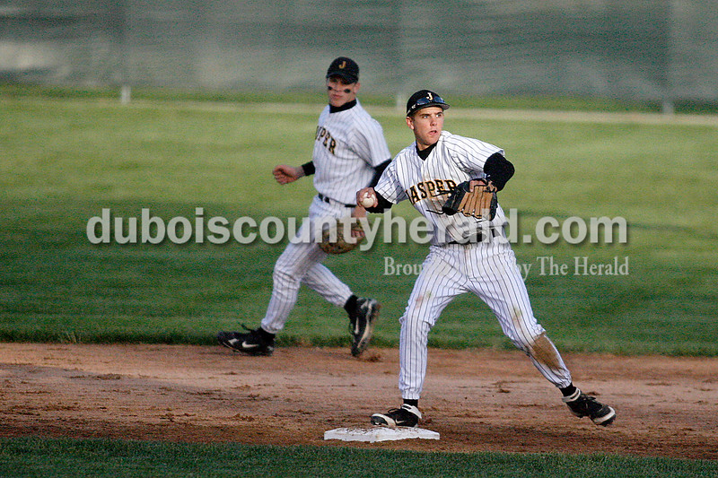 Rachel Mummey/The Herald<br /> Jasper's Caleb Begle fielded a ball to first base during their game against Heritage Hills at Ruxer Field on Monday evening.