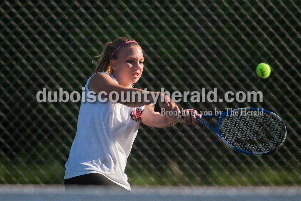Rachel Mummey/The Herald<br /> Southridge's Alex Herron hit the ball during a singles match against Heritage Hills' Allison Baron in Lincoln City on Thursday evening.