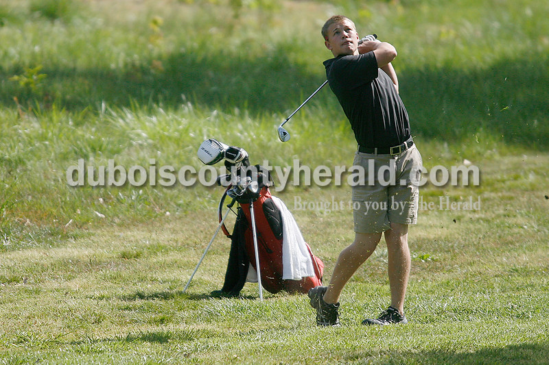 Rachel Mummey/The Herald<br /> Southridge's Beau Schneider worked to get his ball away from the edge of the faraway of hole two during their competition against Jasper at Huntingburg Country Club on Wednesday.