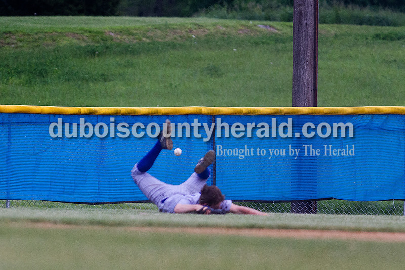 Brooke Stevens/The Herald<br /> Northeast Dubois Joe Gress missed a ball to the outfield during Tuesday nights game against Barr Reeve at Dubois.