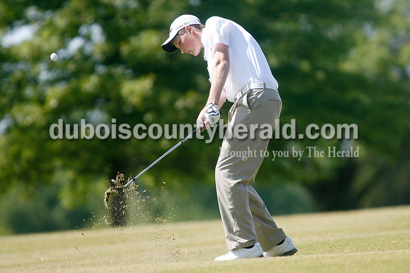 Rachel Mummey/The Herald<br /> Jasper's Ian Weyer hit the ball down the fareway on hole one during their golf competition against Southridge at Huntingburg Country Club on Wednesday.