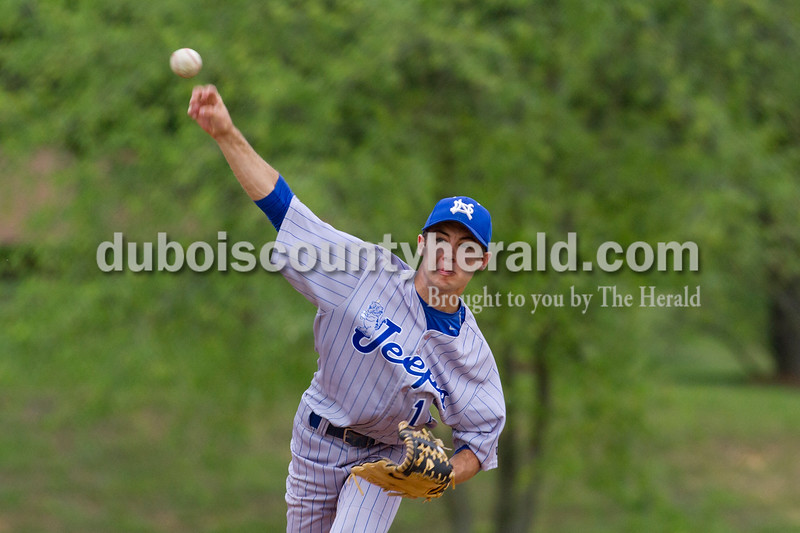Brooke Stevens/The Herald<br /> Northeast Dubois' Austin Kunz pitched the ball during Tuesday nights game against Barr Reeve at Dubois.