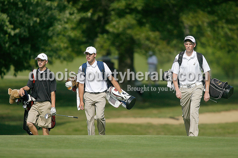 Rachel Mummey/The Herald<br /> Southridge's Tyler Gray, Jasper's Will Seger and Ian Weyer made their way down the faraway of hole two at Huntingburg Country Club on Wednesday.