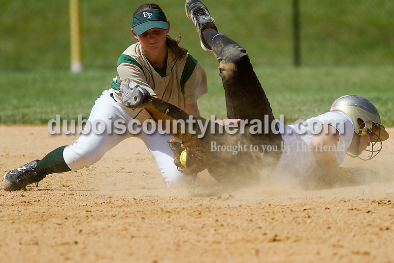 Brooke Stevens/The Herald<br /> Forest Park's Emily Gutgsell tagged Jasper's Emily Beckman as she slide into second base during Saturdays game at Jasper.