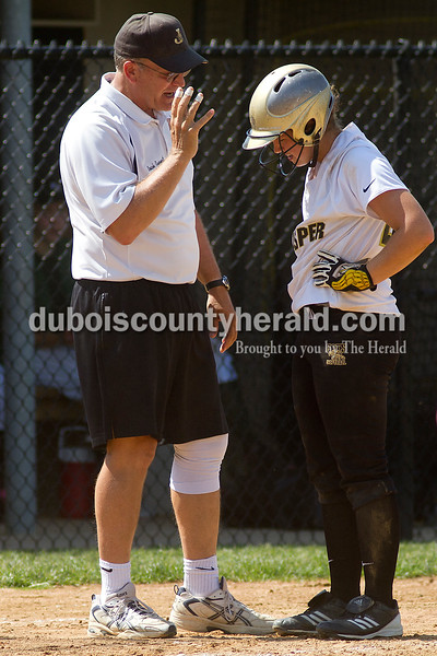 Brooke Stevens/The Herald<br /> Jasper head coach Tom Rupert spoke to Emily Beckman after she was  out at third base during Saturdays game against Forest Park at Jasper.