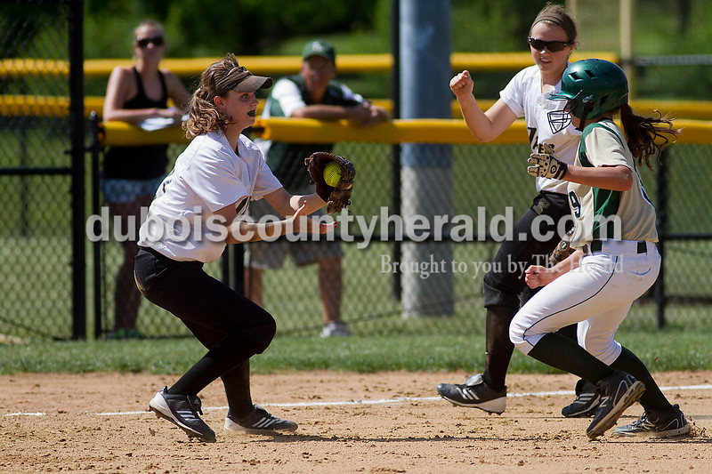 Brooke Stevens/The Herald <br /> Jasper's Katie Krempp went to tag Forest Park's Emily Gutgsell with back up from Emily Beckman during Saturdays game at Jasper.