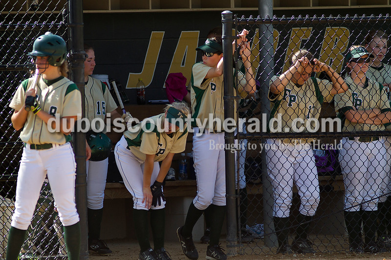 Brooke Stevens/The Herald<br /> Forest Park teammates watched from the dugout during Saturdays game against Jasper at Jasper.