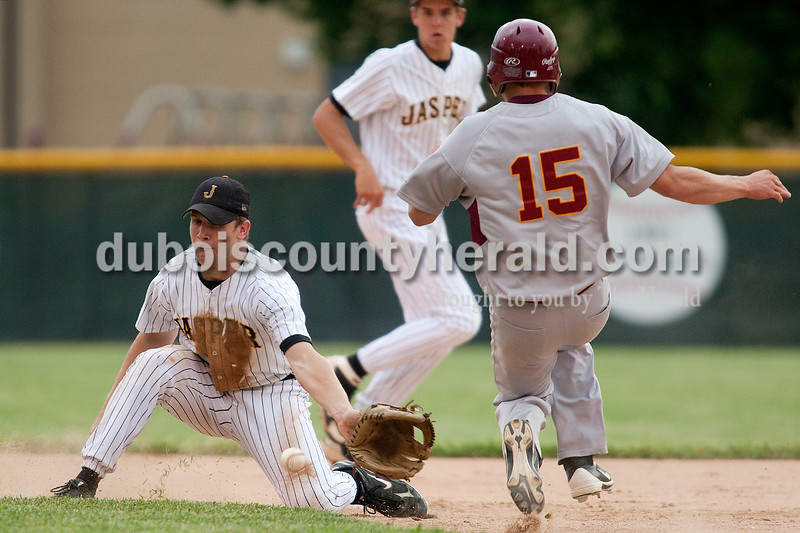 Jasper second baseman Nick Gobert scooped up the throw to second but not in time to prevent Gibson Southern's Brooks Martin from stealing the base during Thursday's game at Ruxer Field in Jasper. The Wildcats won 9-8. Dave Weatherwax/The Herald