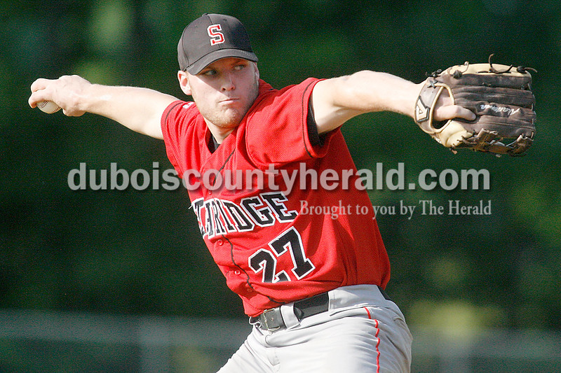 Rachel Mummey/The Herald<br /> Southridge's Kyle Seger pitched for the Raiders during their game against Heritage Hills in Lincoln City on Tuesday evening. The Patriots won 2-1.