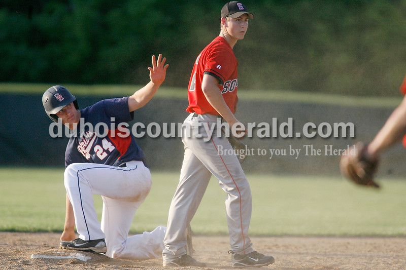 Rachel Mummey/The Herald<br /> Heritage Hills' Devon Wahl signaled to the refaree at second base after Southridge's Zach Stetter attempted a tag out during their game in Lincoln City on Tuesday evening. The Patriots won 2-1.