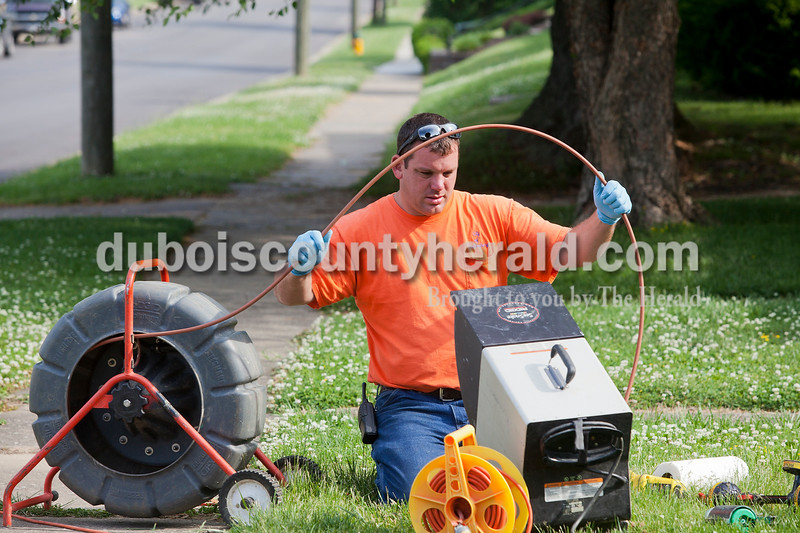Rachel Mummey/The Herald<br /> Foreman of the Waste-Water Department Brad Coomer of Huntingburg used a video scope to inspect a sewer line on Jackson St. in Huntingburg on Thursday morning. The accompanying LCD monitor allows Coomer to see where the damaged areas are on the line.
