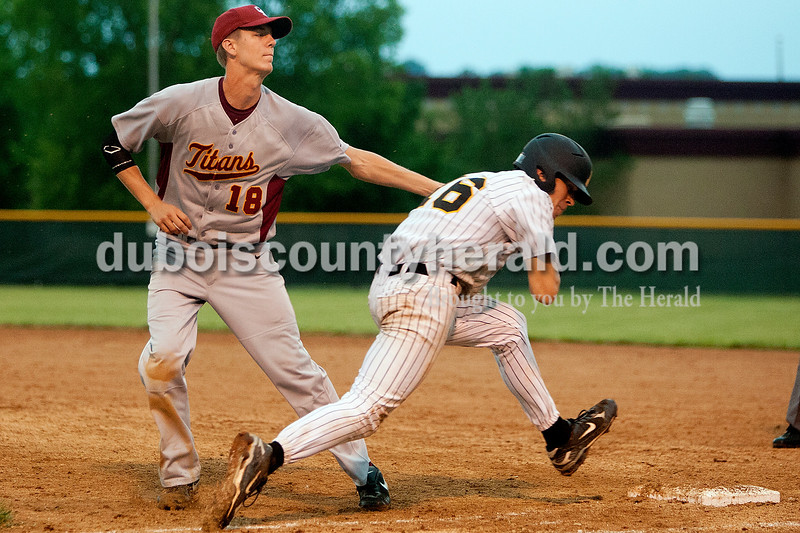 Gibson Southern first baseman Reed Oing tagged out Jasper's Nick Gobert during Thursday's game at Ruxer Field in Jasper. The Wildcats won 9-8. Dave Weatherwax/The Herald