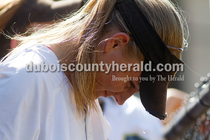 Brooke Stevens/The Herald<br /> Jasper's Megan Bauer pored water on her head to cool off during Saturdays game against Forest Park at Jasper.