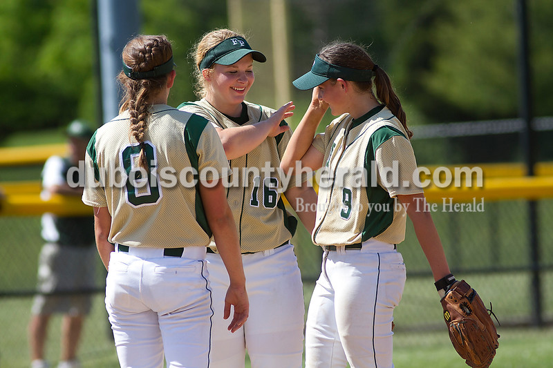 Brooke Stevens/The Herald<br /> Forest Park teammates, from left, Allison Hoffman, Adria Giesler and Emily Gutgsell talked at the pitchers mound during Saturdays game against Jasper at Jasper.