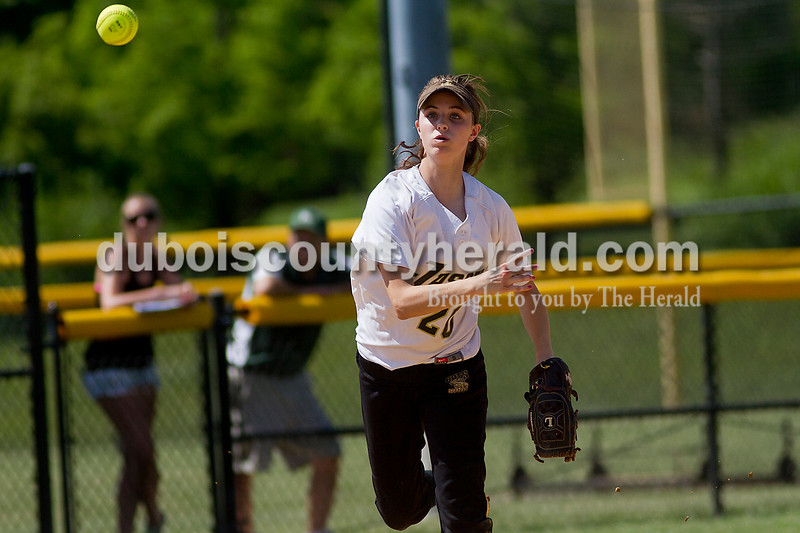 Brooke Stevens/The Herald<br /> Jasper's Katie Krempp threw the ball toward first base during Saturdays game against Forest Park at Jasper.