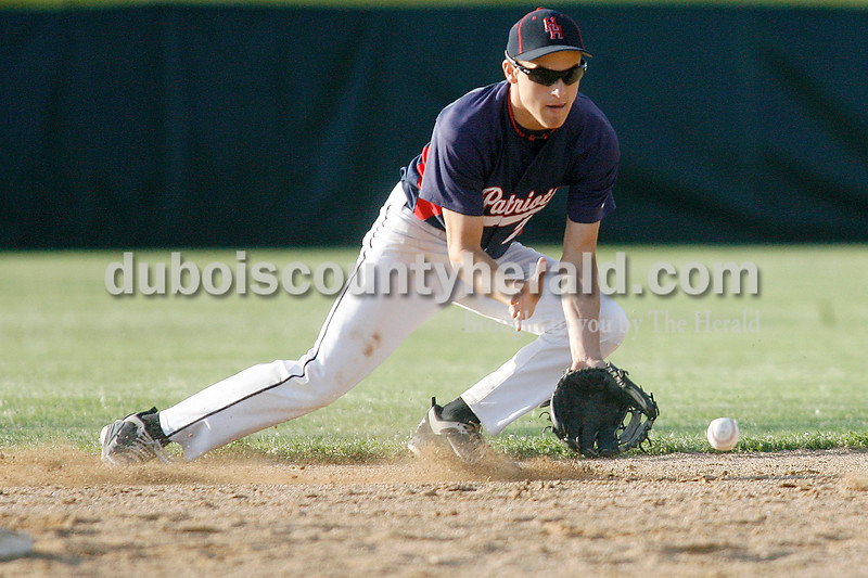 Rachel Mummey/The Herald<br /> Heritage Hills' Cole Burroughs fielded a ground ball during their game against Southridge in Lincoln City on Tuesday evening. The Patriots won 2-1.