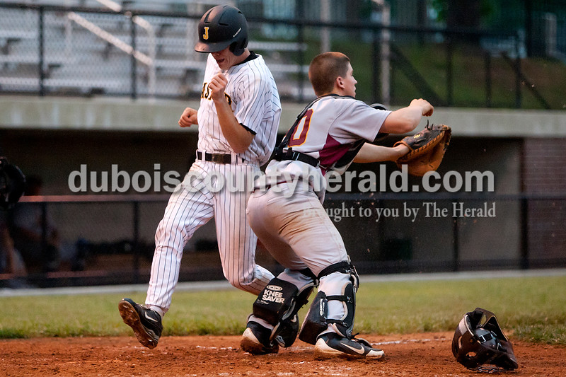 Jasper's Devon Traylor slipped past Gibson Southern catcher Garrett Elpers to score the go ahead run in the bottom of the sixth inning during Thursday's game at Ruxer Field in Jasper. The Wildcats won 9-8. Dave Weatherwax/The Herald
