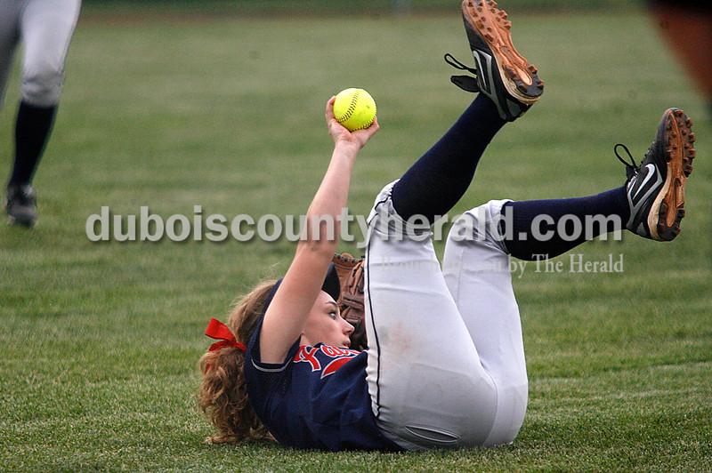 Rachel Mummey/The Herald<br /> Heritage Hills'  Abby Fischer showed she caught the ball on a pop fly during their game against Jasper in Washington on Monday evening. Heritage Hills won 3-0.