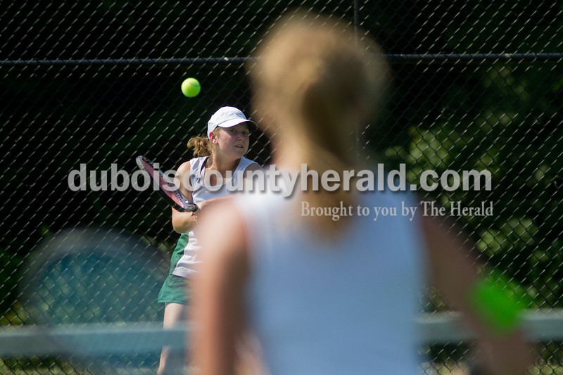 Brooke Stevens/The Herald<br /> Forest Park's Amie Weyer hit the ball during a match against Jasper at Saturday's tennis sectional at Jasper.