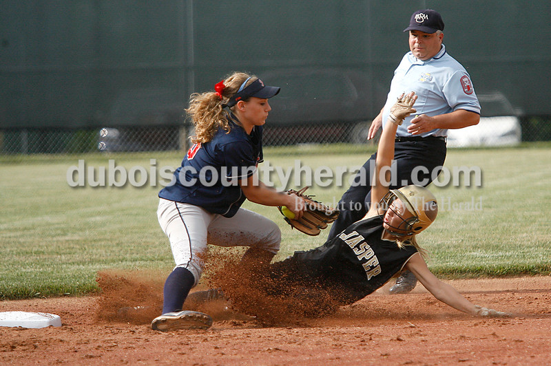 Rachel Mummey/The Herald<br /> Jasper's Whitney Weidenbenner slid into third base safely as Heritage HIlls' Abby Firscher attempted to make a tag out during their game in Washington on Monday evening. Heritage Hills won 3-0.