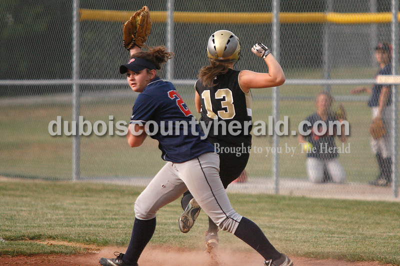 Rachel Mummey/The Herald<br /> Heritage Hills' Felicia Leibering got a tag out on Jasper's Rachel Bartley at first base during their game in Washington on Monday evening. Heritage Hills won 3-0.