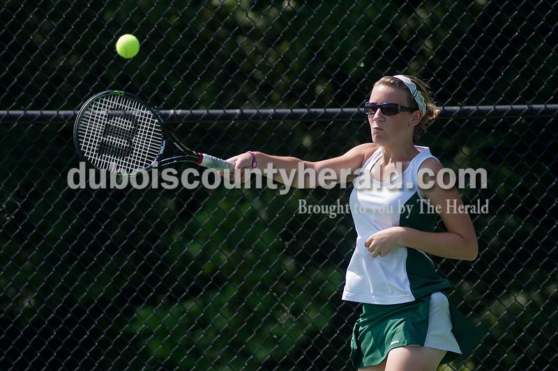 Brooke Stevens/The Herald<br /> Forest Park's Jordan Buechler hit the ball during a match against Jasper at Saturday's tennis sectional at Jasper.