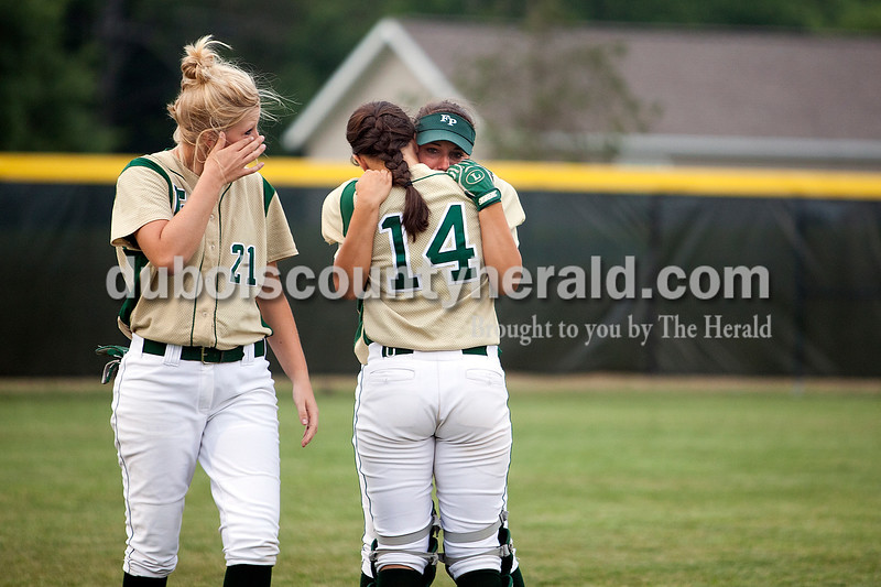 Forest Park teammates Kylie Blessinger, Shelby Bettag and Kalyn Wendholt comforted each other after the team lost Monday night's Class 2A sectional against South Spencer in Bretzville. The Rangers lost 3-0. Krista Hall/The Herald