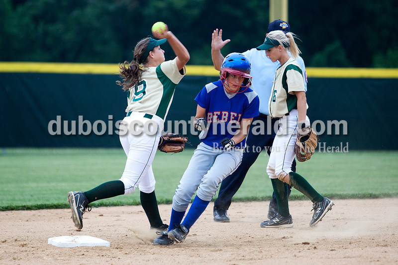 Forest Park's Emily Gutgsell and Victoria Van Winkle teamed up to tag out South Spencer's Kaleigh Goldman at second base in the first inning of Monday night's Class 2A softball sectional in Bretzville. The Rangers lost 3-0. Krista Hall/The Herald