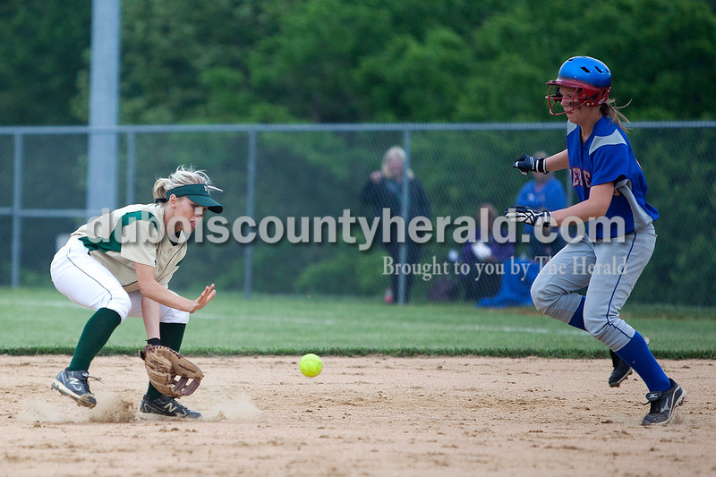 Forest Park's Victoria Van Winkle scooped up a ball and tagged out South Spencer's Chandra Schroeder in the fourth inning of Monday night's Class 2A softball sectional in Bretzville. The Rangers lost 3-0. Krista Hall/The Herald