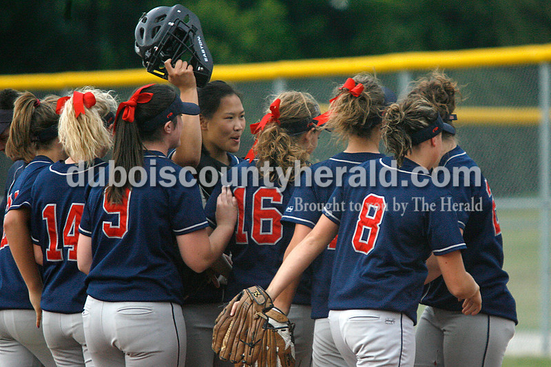 Rachel Mummey/The Herald<br /> Heritage Hills' Ashley Bauer, Heidi Greulich, Kaitlin Kralj, Hayli Scott, Abby Firscher, Kaylee Zoglman, Allison Van Winkle, and Felicia Leibering gathered in celebration after a successful defensive inning as they walked off the field between innings during their game against Jasper in Washington on Monday evening. Heritage Hills won 3-0.