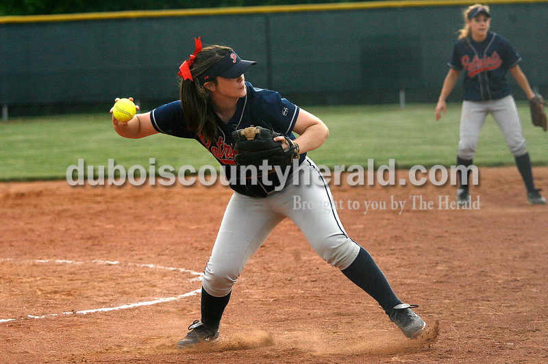 Rachel Mummey/The Herald<br /> Heritage Hills' pitcher Kaitlin Kralj fielded a bunted ball to first base during their game against Jasper in Washington on Monday evening. Heritage Hills won 3-0.