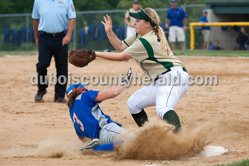 Forest Park's Adria Giesler waited to catch a ball while South Spencer's Chandra Schroeder slid safely into third base in the sixth inning of Monday night's Class 2A softball sectional in Bretzville. The Rangers lost 3-0. Krista Hall/The Herald