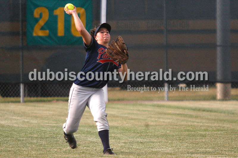 Rachel Mummey/The Herald<br /> Heritage Hills' Allison Van Winkle threw a caught ball back in from the outfield during their game against Jasper in Washington on Monday evening. Heritage Hills won 3-0.