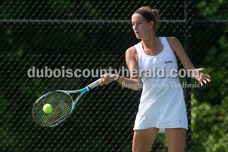 Brooke Stevens/The Herald<br /> Jasper's Abby Rogers hit the ball during a match against Forest Park at Saturday's tennis sectional at Jasper.
