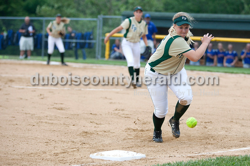 Forest Park's Adria Giesler chased after a ball hit by South Spencer's Kaleigh Goldman in the first inning of Monday night's Class 2A softball sectional in Bretzville. The Rangers lost 3-0. Krista Hall/The Herald