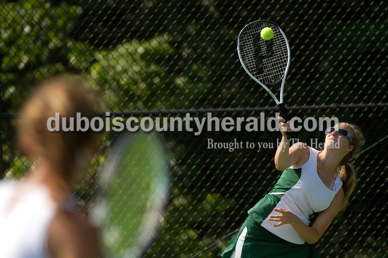 Brooke Stevens/The Herald<br /> Forest Park's Rachel Hentrup hit the ball during a match against Jasper at Saturday's tennis sectional at Jasper.