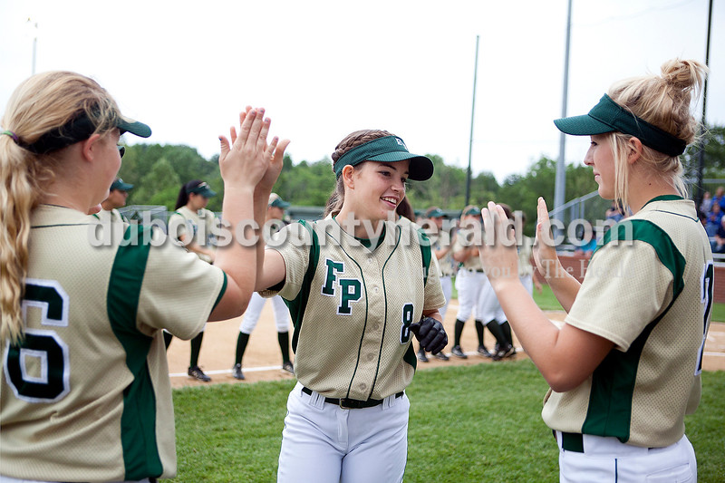 Forest Park's Allison Hoffman gave high fives to teammates Adria Giesler and Kylie Blessinger after her name was called before the start of Monday night's Class 2A softball sectional in Bretzville. The Rangers lost 3-0. Krista Hall/The Herald