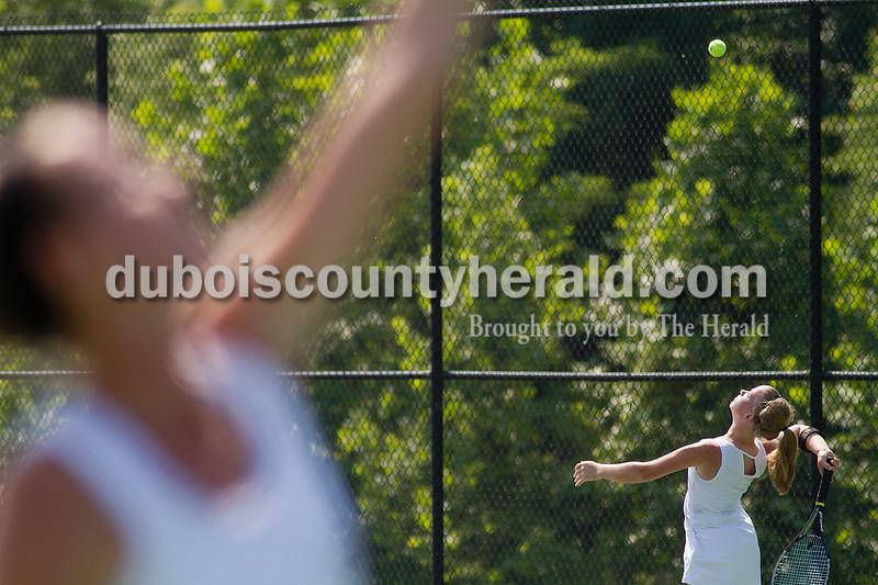 Brooke Stevens/The Herald<br /> Jasper's Mekenzie Hilsmeyer hit the ball during a match against Forest Park at Saturday's tennis sectional at Jasper.