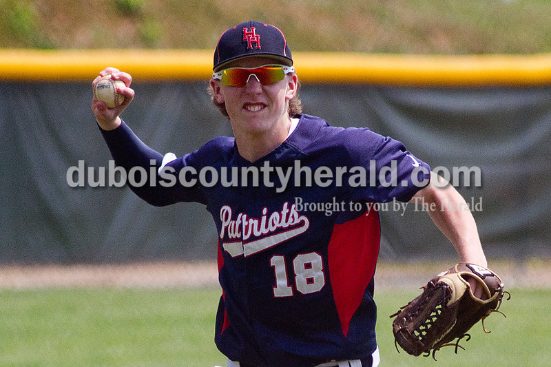 Brooke Stevens/The Herald<br /> Heritage Hills' Tyler Ward threw the ball to first during Mondays Class 3A Baseball Sectional at Jasper. Heritage Hills defeated Vincennes 3-1.