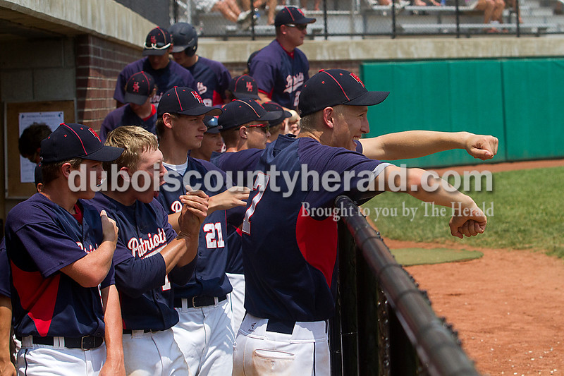 Brooke Stevens/The Herald<br /> Heritage Hills' teammates cheered from the dugout after the winning run during Mondays Class 3A Baseball Sectional at Jasper. Heritage Hills defeated Vincennes 3-1.