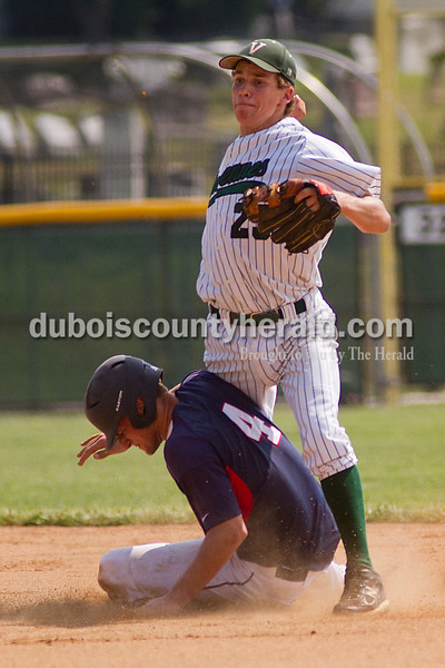 Brooke Stevens/The Herald<br /> Heritage Hills' Damon Wahl slid into second with Vincennes' Brandt Nowaskie covering the plate during Mondays Class 3A Baseball Sectional at Jasper. Heritage Hills defeated Vincennes 3-1.