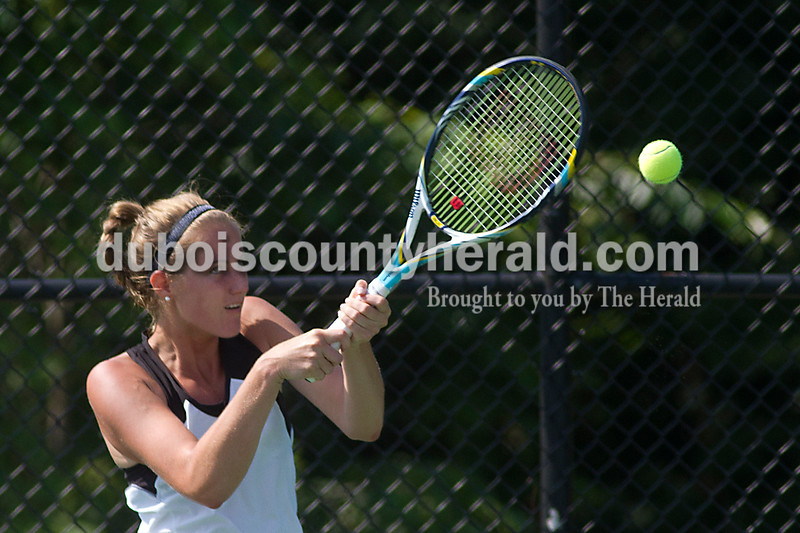 Brooke Stevens/The Herald<br /> Jasper's Abby Rogers hit the ball during her match against Columbus North during Saturdays Semi-State competition.