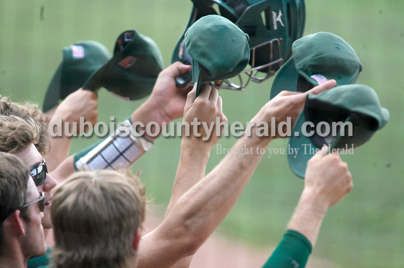 Rachel Mummey/The Herald<br /> Forest Park's Alec Hassfurther, Evan Olinger, Bryan Hurst and Lance Buechler held up rally caps in support of their team during Monday's Class 2A baseball sectional against South Spencer at League Stadium in Huntingburg. Forest Park lost 3-2.