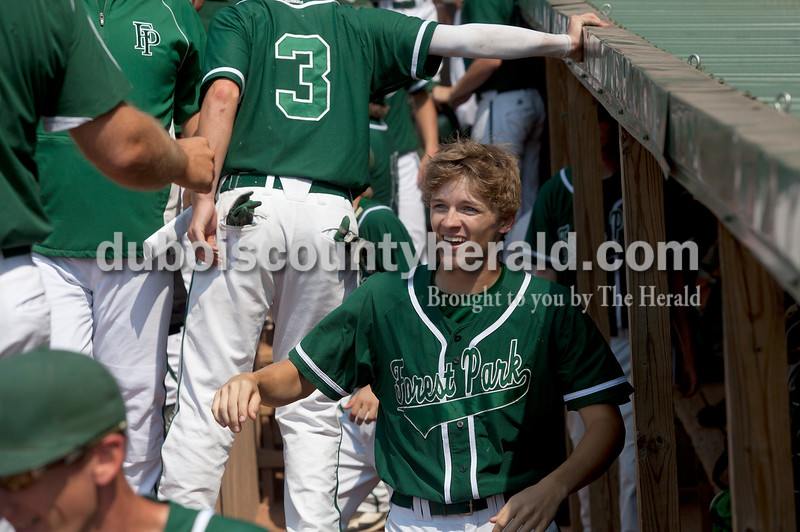 Rachel Mummey/The Herald<br /> Forest Park's Evan Olinger received congratulations in the dug out after scoring during Monday's Class 2A baseball sectional against South Spencer at League Stadium in Huntingburg. Forest Park lost 3-2.