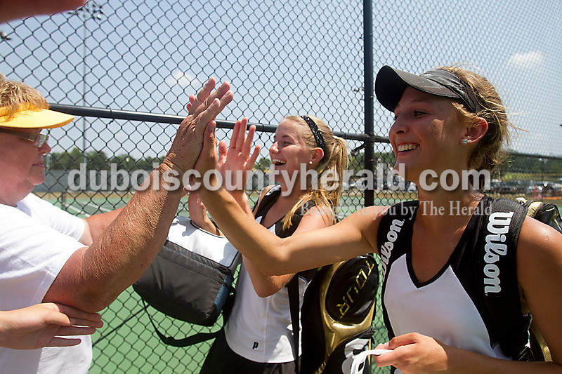 Brooke Stevens/The Herald<br /> Jasper doubles team Elizabeth Theil, right, and Ashley Rogers are congratulated after winning the deciding match by Judy Yarbrough during Saturdays Semi-State competition at Jasper.