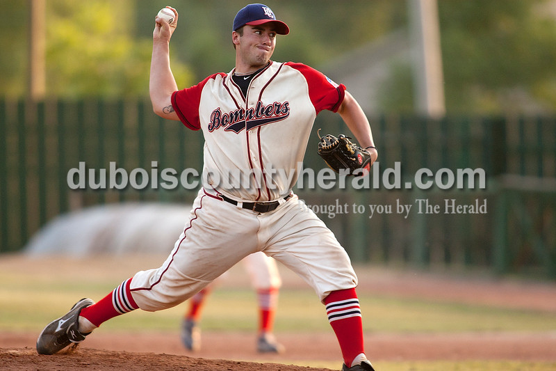 Dubois County Bombers' Alex Britt delivered a pitch during Wednesday night's game against Quincy at League Stadium in Huntingburg. The Bombers won 9-5. Dave Weatherwax/The Herald
