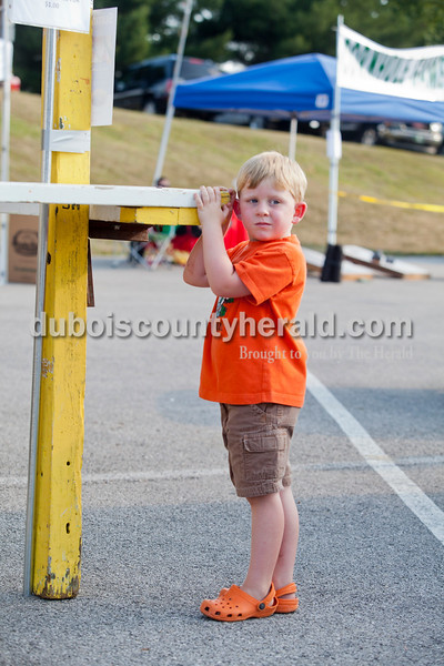 Rachel Mummey/The Herald<br /> Logan Fischer of Santa Claus, 4, took in the sites while at the game stands at the Heimatfest in Ferdinand on Friday evening. Logan was at the fest with his brother Grant, 5, and his grandparents Gail and Rich Heichelbech of Ferdinand.
