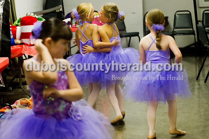 Brooke Stevens/The Herald <br /> Dancers, from left, Grace Keller of Mariah Hill, 6, Erica Frank of Jasper,6, Lauren Hayes of Jasper, 7, and Lilly Hulsman of Jasper, 5, waited backstage Friday evening at the Jasper Arts Center during dress rehearsal for Dance Central Academy's recital. Performers age 3-8 danced, sang, and acted during rehearsal for the following days recital at the Jasper Arts Center.