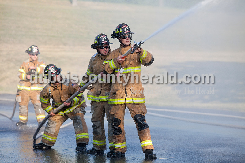 Rachel Mummey/The Herald<br /> Members of Ferdinand's Volunteer Fire Department Chris Schipp, Doug Lindauer, his brother, Craig Lindauer, and their cousin, Jake Lindauer, all of Ferdinand, participated in the waterfall competition at the Heimatfest in Ferdinand on Friday evening. Teams from various fire departments across the county came to participate in the event. Laura Reckelhoff of Ferdinand was the Ferdinand team's coach.